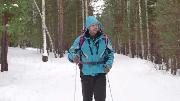 Thumbnail for Man with Backpack Walking Throw the Winter Forest