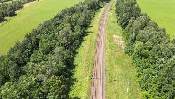 Thumbnail for Train Way Through green grassed countryside, Aerial