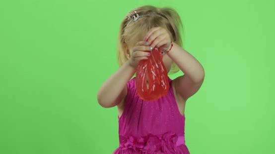 Thumbnail for Child Having Fun Making Red Slime. Kid Playing with Hand Made Toy Slime