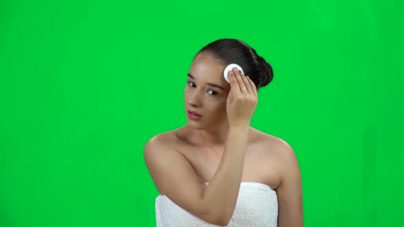 Thumbnail for Woman with Bare Shoulders in White Towel Using Cotton Pad, Cleans Her Face. Slow Motion