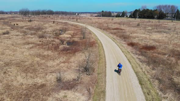 Thumbnail for Aerial Iew Cyclist Is Engaged in a Healthy Lifestyle. Bike Ride in the Park. A Quadrocopter That