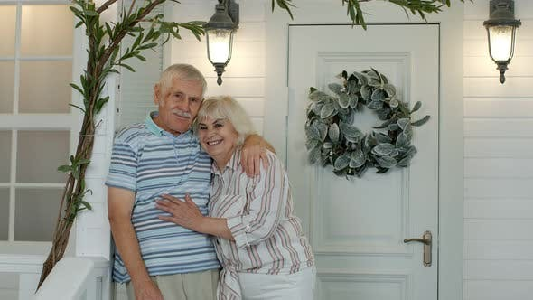 Thumbnail for Senior Couple Husband and Wife Embracing, Showing Love Each To Other in Porch at Home. Mature Family