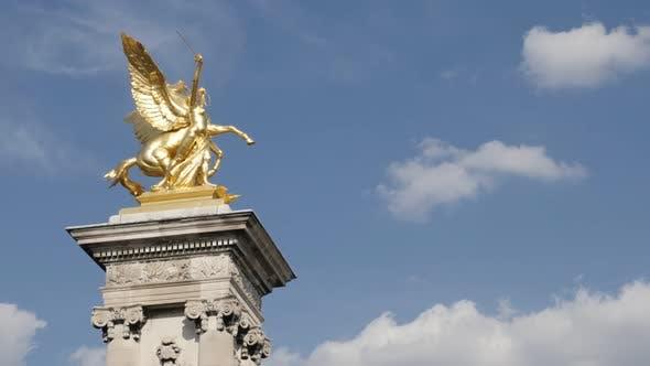 Detailed columns and sculptures of Pont Alexandre III bridge 4K 2160p 30fps UltraHD footage - Golden