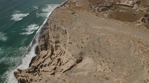 Weird and stunning rock formations on Vlychada Beach (Santorini Greece by drone)