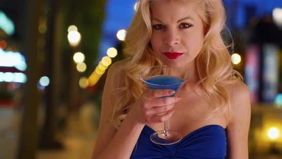 Thumbnail for Beautiful sexy woman drinking cocktail alone