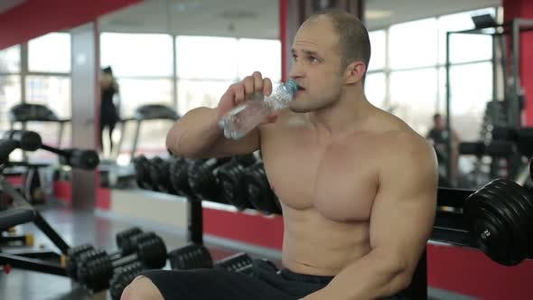 Thumbnail for Sportive Man Tired After Active Training in Gym, Enjoying Gulp of Fresh Water