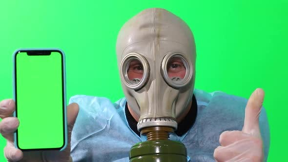 Man in a gas mask on a green background