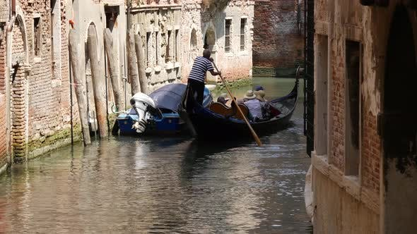 Thumbnail for Gondola in a narrow canal ging around the corner in Venice