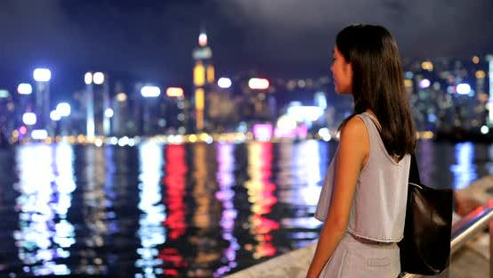 Thumbnail for Woman visiting Hong Kong at night