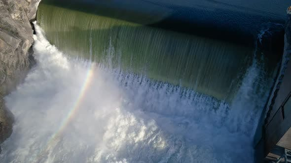 Thumbnail for Breathtaking Dam Waterfall Rainbow Slow Motion Aerial
