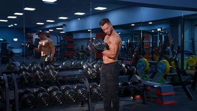 Motivated man training muscles