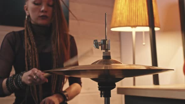 Gothic Woman Playing Drums In Studio