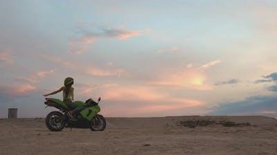 Cool Woman in Helmet on Motorbike on Beach