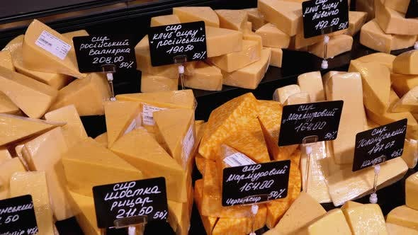 Thumbnail for Various Chopped Pieces of Cheese with Price Tags on a Showcase in a Store
