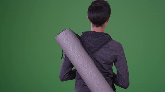 Thumbnail for Healthy black woman with yoga mat waiting for class to start on green screen