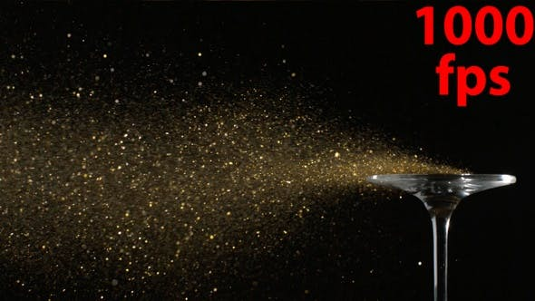 Thumbnail for Golden Glitter Flying In The Air Is Blown Away From A Glass In Slow Motion On Black Background 4K