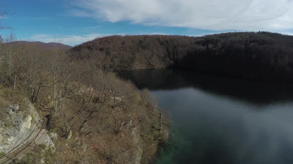 Thumbnail for Aerial view of a hiking trail and lake, Plitvice Park