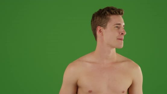 Thumbnail for Caucasian male staring off into the distance in his swimsuit on green screen