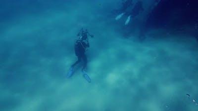 Scuba diver next to a wreck