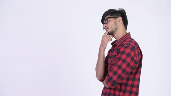 Thumbnail for Profile View of Young Handsome Bearded Indian Hipster Man Thinking