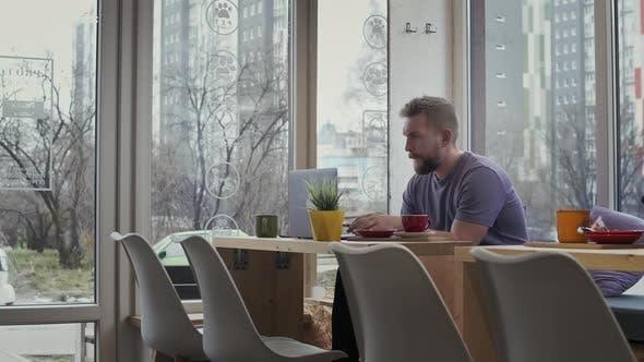 Bearded Man Drinking Coffee