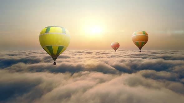 Thumbnail for Aerial View Balloon Flying at Sunset Over the Clouds. Balloon Flight Above the Clouds. The Sun's