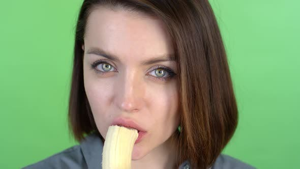 Thumbnail for Face of Young Woman Eating Banana