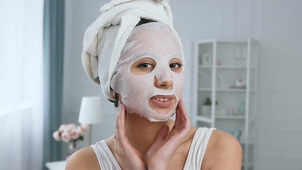 Cover Image for Beautiful Young Woman Fixing Rejuvenating Cosmetic White Tissue Mask