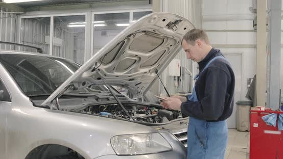 Car Diagnostics With Tablet, Engineer Uses Computer Technologies For Auto Repair