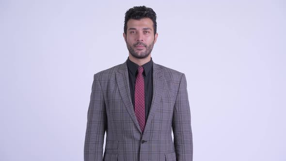 Handsome Bearded Persian Businessman Wearing Suit
