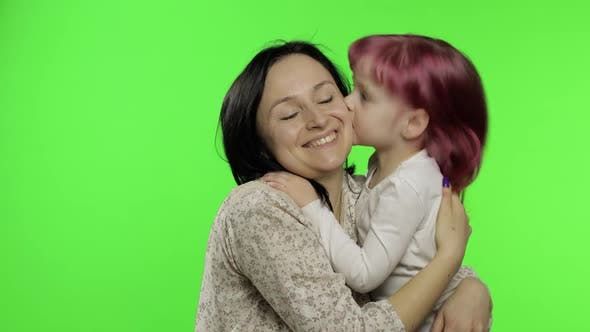 Thumbnail for Mother and Daughter Enjoying Playing, Hug, Embrace, Kiss. Mothers Day. Family