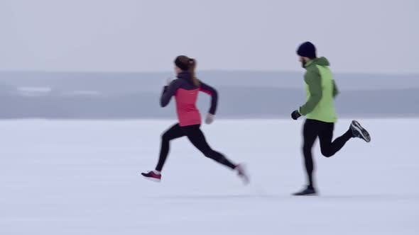 Thumbnail for Man and woman competing in winter race