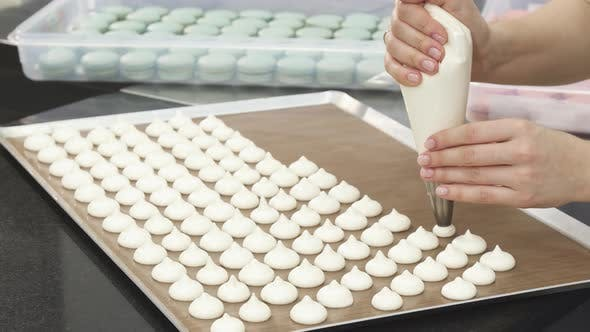 Thumbnail for Cropped Shot of a Confectioner Squeezing Whipped Cream on a Tray