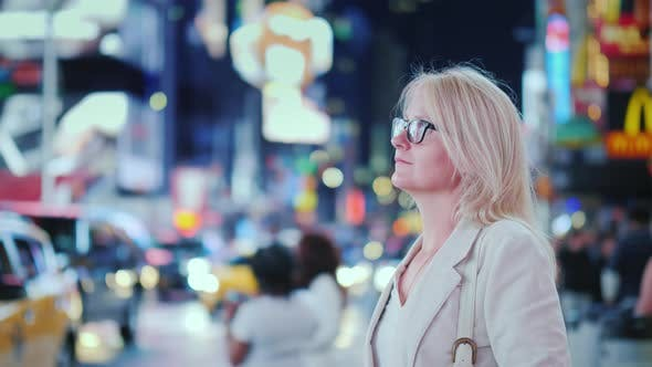 Thumbnail for Attractive Woman Admiring the Lights of the Famous Time Square in New York