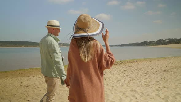 Thumbnail for Back View of Couple Talking and Walking Outdoor