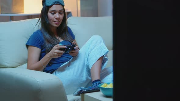 Thumbnail for Woman Sitting on Sofa and Playing Video Games