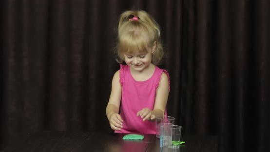 Thumbnail for Child Having Fun Making Green Slime. Kid Playing with Hand Made Toy Slime