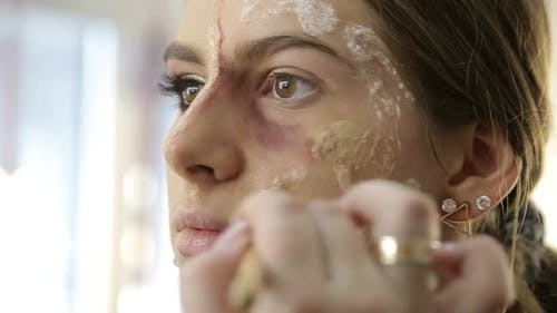 Makeup Artist Make the Girl Halloween Make Up in Studio