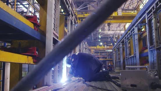 Thumbnail for A Welder Is Working at the Plant