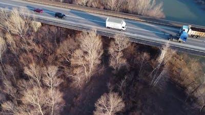 Trucks And Cars On The Bridge
