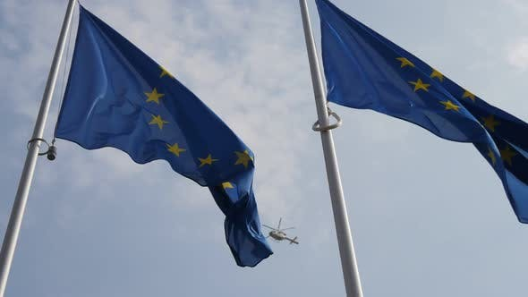 Cover Image for EU Flag with a Police Helicopter on the Background. It Looks Symbolic in Slo-mo