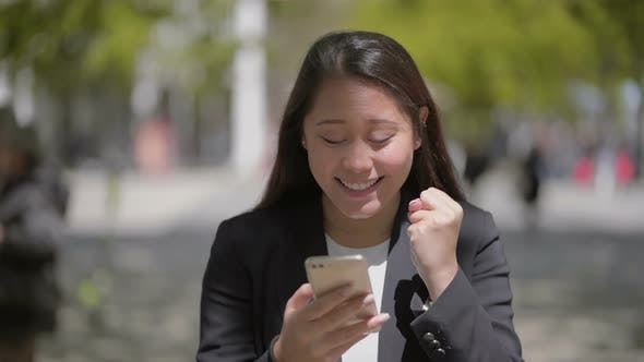 Thumbnail for Attractive Happy Girl Using Smartphone Outdoor