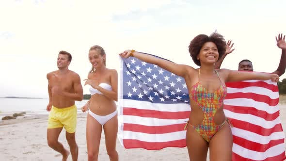 Thumbnail for Friends with American Flag Running on Summer Beach