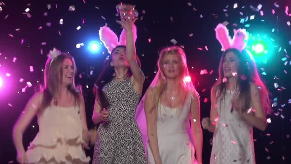 Thumbnail for Girls at Bachelorette Party Dancing, Throws Glitter Confetti. Slow Motion