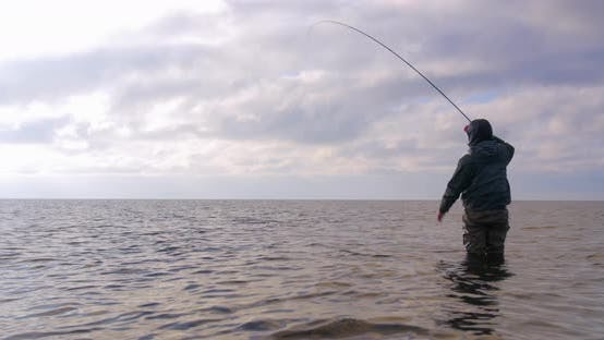 Thumbnail for Man Standing Along the Sea Trying to Catch Sea Trout