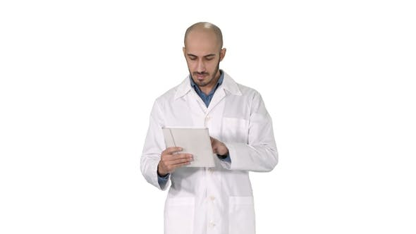 Thumbnail for Mature male doctor holding digital tablet using it and