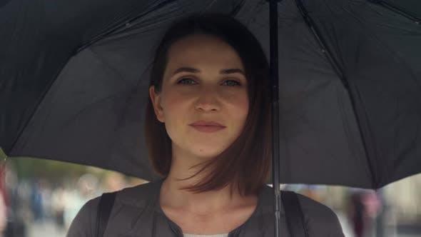 Thumbnail for Portrait of Smiling Woman Under Umbrella in Rain, Tourist Girl Under Umbrella in Rain
