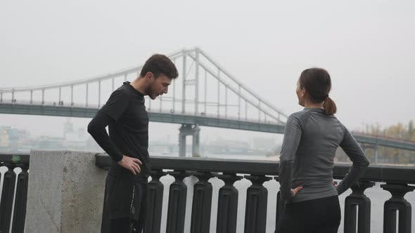 Thumbnail for Young Motivated Happy Running Couple in Sportswear Finished Hard Training and Resting After Workouts