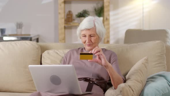 Thumbnail for Elderly Woman Shopping Online on Laptop