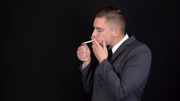 Thumbnail for The Young Businessman Could Not Light a Cigarette. The Lighter Did Not Light Up. Man in a Black Suit